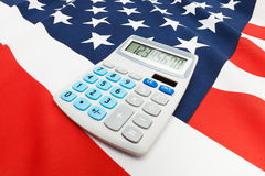 National flag with calculator over it - United States Royalty Free Stock Images