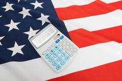 National flag with calculator over it - USA Stock Photo