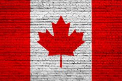 National flag of Canada on a brick royalty free stock photos