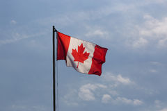 National flag of Canada on a flagpole. In front of blue sky royalty free stock photography