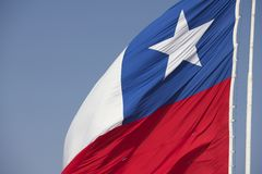 National flag of Chile on a pole at Morro de Arica hill, Arica, Chile. Stock Photos