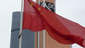 The national flag of China. Against the backdrop of skyscrapers stock video footage