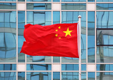 China National Flag. National flag of China against office building stock photo