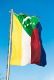 National flag of Comoros on flagpole Royalty Free Stock Images