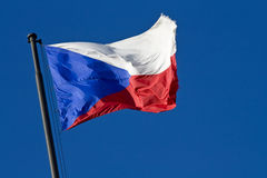 National flag of the Czech. Symbol of the czech republic, state flag of the czech republic, czech republic flag blowing in the wind, flag on a blue background Stock Photos