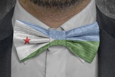 National flag of Djibouti on bowtie business man suit stock images