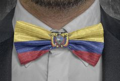 National flag of Ecuador on bowtie business man suit royalty free stock image