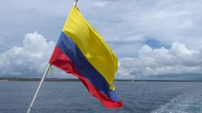 National flag of Ecuador flying in a wind on a boat, Galapagos islands stock footage
