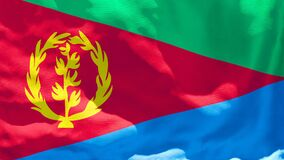 The national flag of Eritrea flutters in the wind