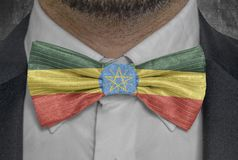 National Flag of Ethiopia on bowtie business man suit royalty free stock photo