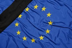 National flag of european union with black mourning ribbon. Waving national flag of european union with black mourning ribbon royalty free stock images