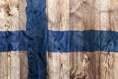 National flag of Finland, wooden background Stock Image