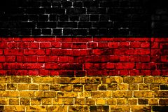 National flag of Germany on a brick background. stock photography