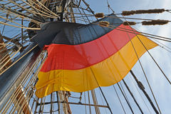 National flag of Germany flutters among tackles of the sailing vessel Royalty Free Stock Image