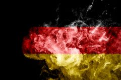 National flag of Germany. From thick colored smoke on a black isolated background Stock Image
