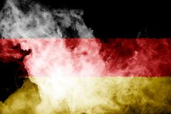 National flag of Germany. From thick colored smoke on a black isolated background vector illustration