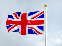 Union Jack, British flag waving in the wind. National flag of the Great Britain and Northern Ireland. The present design of the Union Flag dates from a Royal Royalty Free Stock Photos