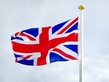 Union Jack, British flag waving in the wind. National flag of the Great Britain and Northern Ireland. The present design of the Union Flag dates from a Royal Stock Images