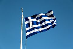 National flag of Greece against blue sky background.  Royalty Free Stock Images
