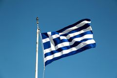 National flag of Greece against blue sky background.  Royalty Free Stock Photography