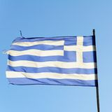 National Flag of Greece. With blue sky in background Stock Photo