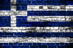 National flag of Greece on a brick background. stock photos