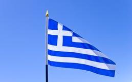National flag of Greece on flagpole. National flag of Greece over blue sky Stock Photo