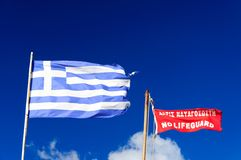 National Flag of Greece and No LifeGuard Flag Royalty Free Stock Images