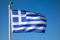 National flag of Greece. Greece flag waving in the wind over blue sky Stock Image