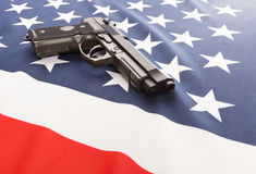National flag with hand gun over it series - United States Stock Photos