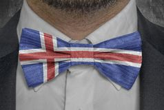 National Flag of Iceland on bowtie business man suit royalty free stock images