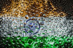 National flag of  India with drops. Close-up of a drop of water against a background of the national flag of  India on an isolated background Royalty Free Stock Photo