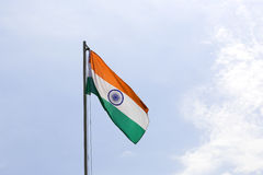 National flag of India on a flagpole. In front of blue sky royalty free stock image