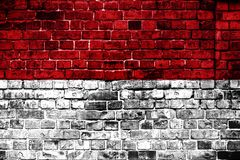National flag of Indonesia on a brick background. stock photo