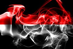 National flag of Indonesia made from colored smoke isolated on black background.  royalty free stock photo