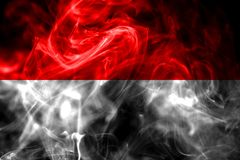 National flag of Indonesia made from colored smoke isolated on black background. Abstract silky wave background.  stock image