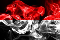National flag of Indonesia made from colored smoke isolated on black background.  royalty free stock photos