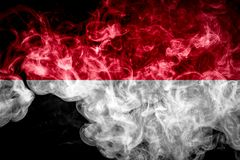 National flag of Indonesia. From thick colored smoke on a black isolated background stock photos