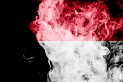 National flag of Indonesia. From thick colored smoke on a black isolated background royalty free stock photo