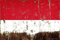 National flag of Indonesia on metal texture. National flag of Indonesia on rusty metal texture stock images