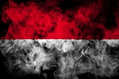 National flag of Indonesia from thick colored smoke. On a black isolated background stock photography