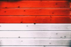 National flag of Indonesia. On a wooden background stock photo