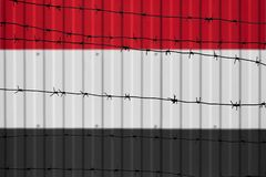 National flag of Iraq on fence. stock image