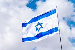 National flag of Israel on a flagpole.  royalty free stock photos