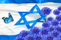 National flag of Israel and spring blue flowers. Independence Day of Israel state. National flag of Israel and spring blue flowers. Israeli National fluttering royalty free stock photos