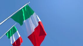 The national flag of Italy is flying in the wind against a blue sky