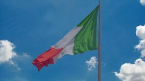 National flag of Italy flying in wind, blue sky background, prosperous country. Stock footage stock video