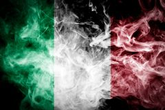 National flag of Italy. From dense colored smoke on a black isolated background Stock Photos