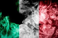 National flag of Italy. From thick colored smoke on a black isolated background Stock Photos