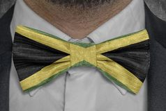 National flag of Jamaica on bowtie business man suit stock image